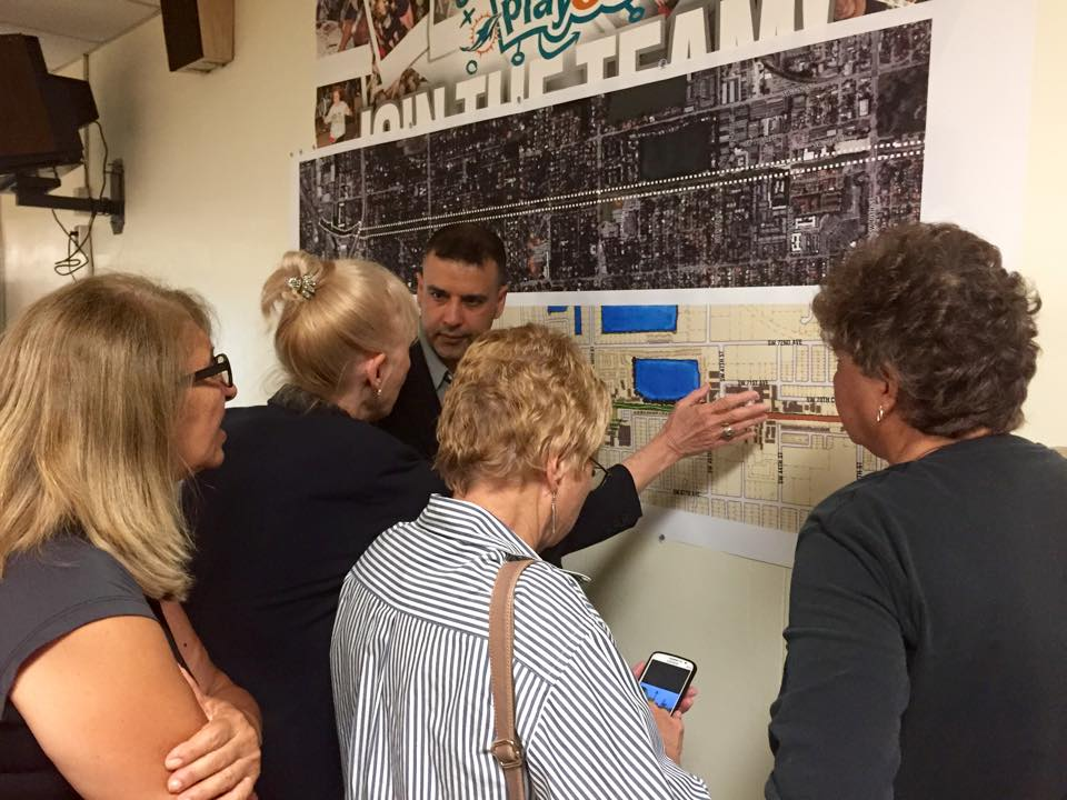 Miami-Dade Urban Design Center Supervisor Shailendra Singh explaining drawing to residents